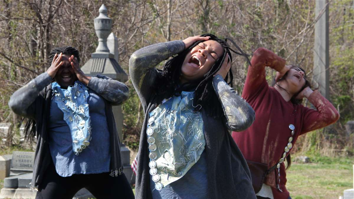 The cast of Beowulf/Grendel (from left) Ainye AnnaDora, Nia Benjamin, and Merri Roshoyan, rehearse in Mount Moriah Cemetery. (Emma Lee/WHYY)