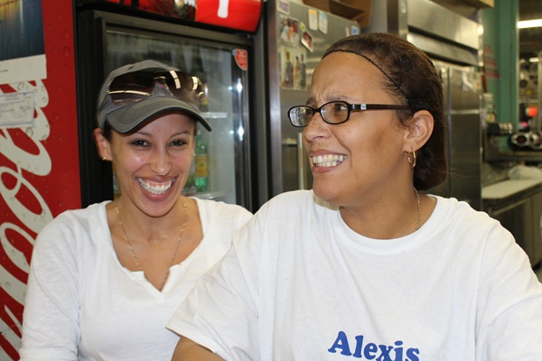 <p><p>Alexis Hernandez (right), owner of Alexis Caribbean Delight, started selling Puerto Rican fare from a food truck. Now she's settled at the Berlin Farmers Market. Her sister often stops by to eat — and to lend a hand. (Elisabeth Perez-Luna/WHYY)</p></p>
