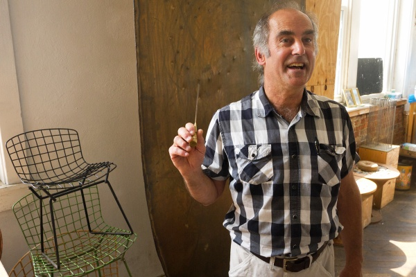 Val Bertoia continues his father's tradition of crafting sound sculptures at the Bertoia Studio in Bally, Pa. (Charlie Kaier/WHYY)
