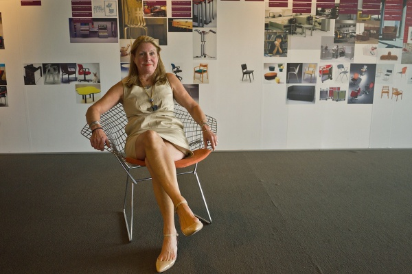 Carol Connell, account manager for Knoll, sits in the Bertoia Diamond Chair. (Charile Kaier/WHYY)