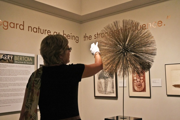 Michener Museum Director and CEO Lisa Hanover curated this show of Harry Bertoia's monoprints, jewelry and sculptures. (Kimberly Paynter/WHYY)