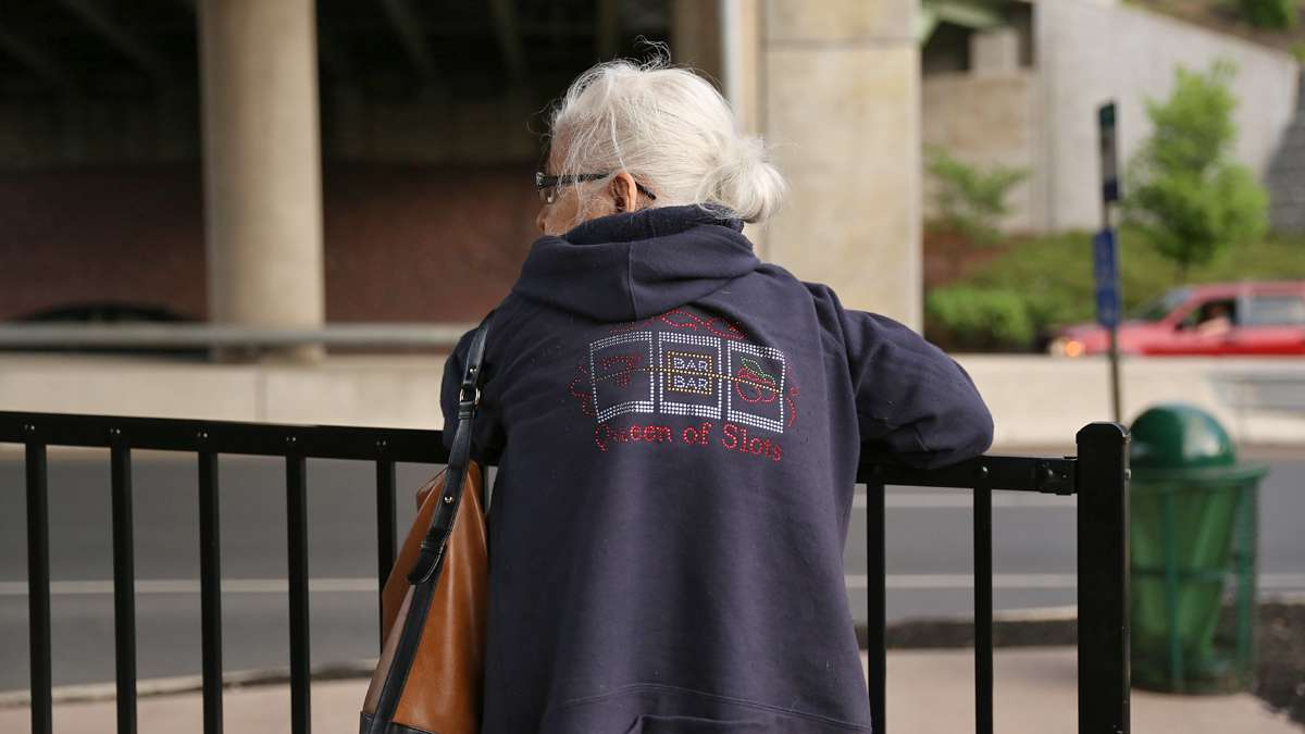 Jean Barber, 75, waits for a bus outside the Sands Resort Casino in Bethlehem, Pa. Barber said she use to travel to Atlantic City, N.J. to gamble and prefers the convenience of the Sands at the former steel plant where her mother and father worked. (Lindsay Lazarski/WHYY)