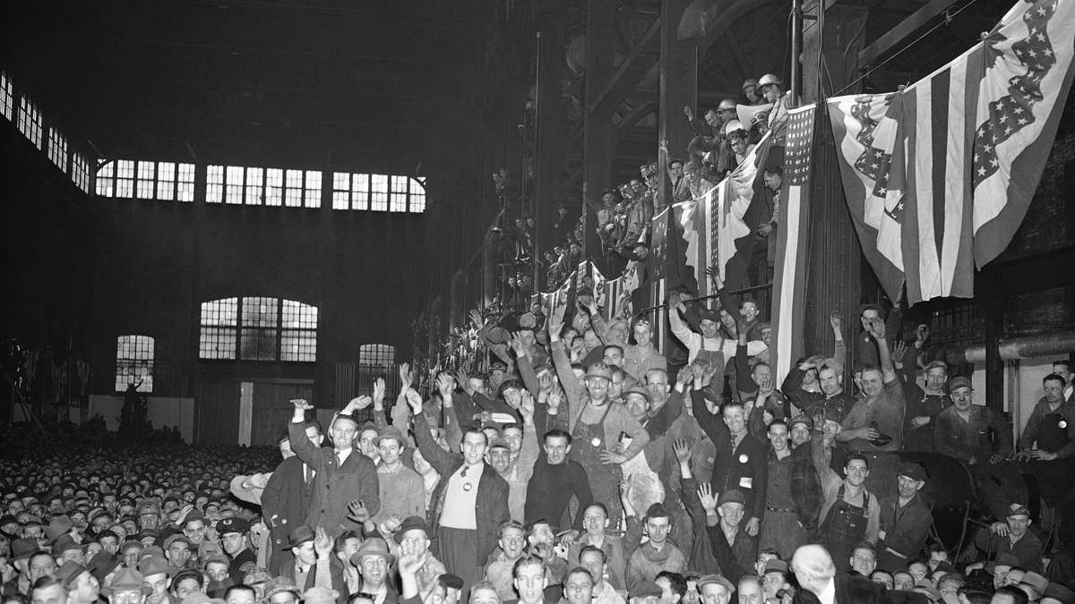 "Employees at a 1941 ceremony where Bethlehem Steel received a Navy ""E"" award. The company employed about 31,000 people during World War II.  (AP file Photo)"