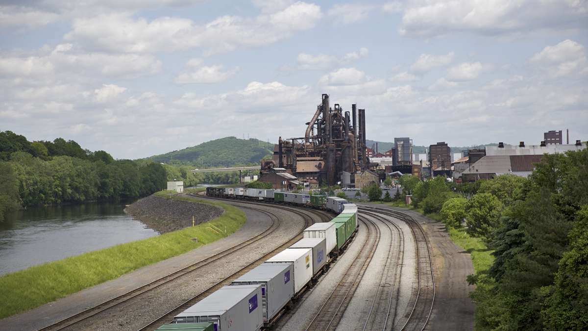 A cargo train rolls by the blast furnaces of the former Bethlehem Steel Co. plant as seen from the Fahy Bridge in Bethlehem, Pa. (Lindsay Lazarski/WHYY)
