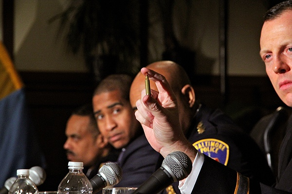 <p>Springettsbury Police Chief Thomas Hyers holds up a bullet of the type used in the Sandy Hook Elementary School shootings during a press conference with Vice President Joe Biden at Girard College. (Emma Lee/for NewsWorks)</p>
