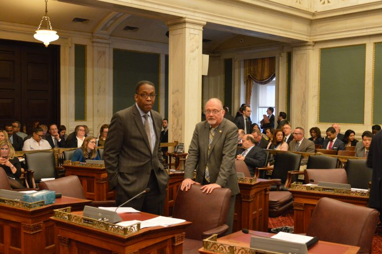 Philadelphia Council President Darrell Clarke and Councilman Bill Greenlee confer Tuesday. (Tom MacDonald/WHYY)