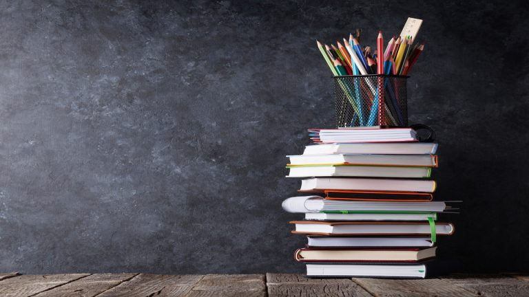 "<a href=""https://www.bigstockphoto.com/image-139814105/stock-photo-books-and-supplies-in-front-of-classroom-chalk-board-back-to-school-concept-with-copy-space"">Books and supplies (Photo Courtesy/BigStockPhoto)</a>"