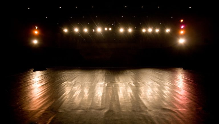(<A href='http://www.bigstockphoto.com/image-3567862/stock-photo-spotlights-on-a-modern-theater-stage'>Big Stock Photo</a>)