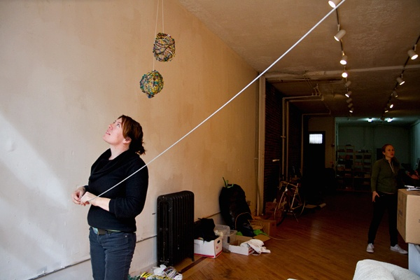 <p>&lt;p&gt;Architect and designer Cary Clouse hangs a wire as part of the Toss exhibit at the Storefront for Urban Innovation in Philadelphia. (Lindsay Lazarski/WHYY)&lt;/p&gt;</p>