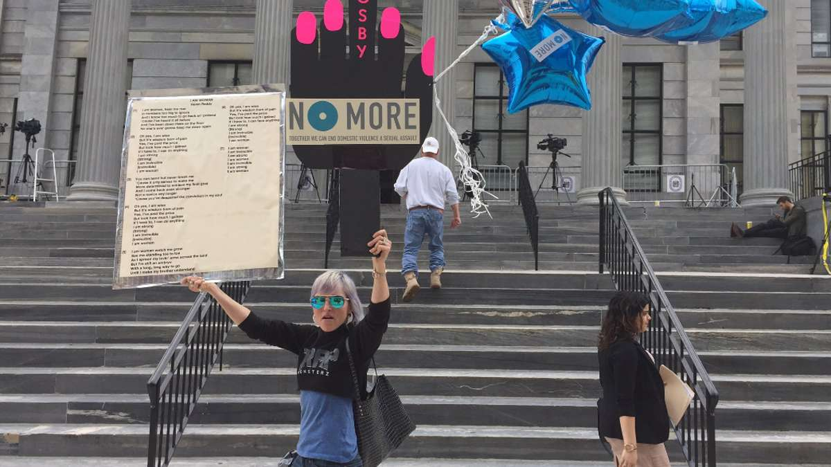 Artist Bird Milliken mounts a musical protest outside of the Montgomery County Courthouse to support Bill Cosby's accusers, and victims of sexual abuse.