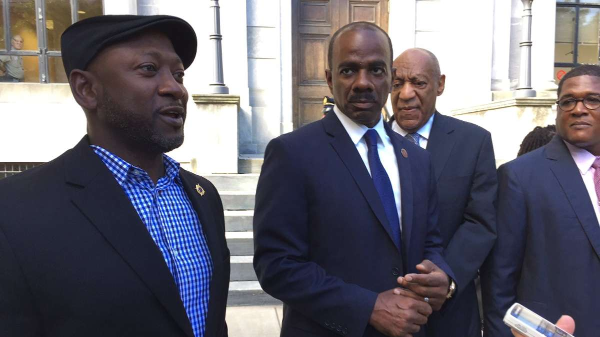 Artist bird Milliken says she was moved protest outside of the Montgomery County Courthouse after seeing the steady stream of celebrities — including comedians Joe Torry and Lewis Dix, shown here — who have escorted and supported Bill Cosby, who is standing trial for sexual assault.