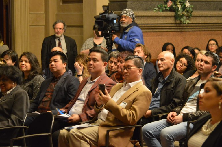 Immigrants at City Hall for business week (Tom MacDonald/WHYY)