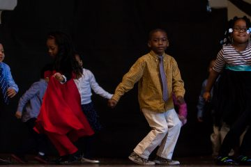 Mifflin School kindergartners perform 'The Twist' as part of Friday's homage to the Civil Rights Movement era. (Brad Larrison/for NewsWorks)