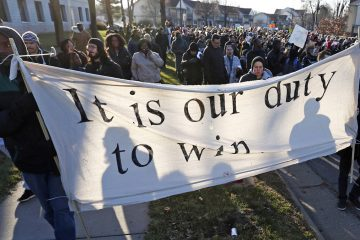 Black Lives Matter supporters are shown in Minneapolis in November 2015 following the fatal shooting of Jamar Clark, a black man, by a Minneapolis police officer. (AP Photo/Jim Mone)