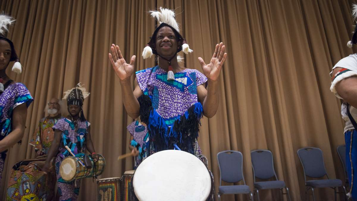 Members of the Universal African Dance & Drum Ensemble perform at the Black History and Culture Showcase inside the Pennsylvania Convention Center in Philadelphia. (Branden Eastwood for NewsWorks)