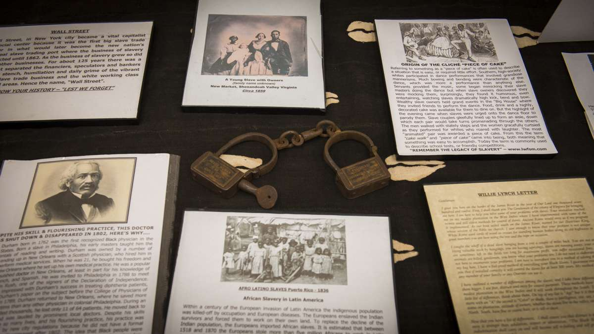 A shackle once worn by a slave is displayed at the Lest We Forget Black Holocaust Museum of Slavery exhibit in the Black History and Culture Showcase in Philadelphia. (Branden Eastwood for NewsWorks)