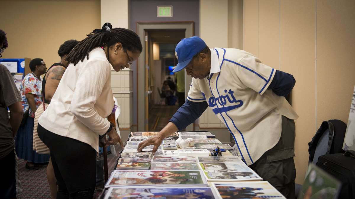 Pedro Sierra, the last Negro League baseball player to be signed by a Major League team, speaks to a guest at the Black History and Culture Showcase inside the Pennsylvania Convention Center in Philadelphia. (Branden Eastwood for NewsWorks)