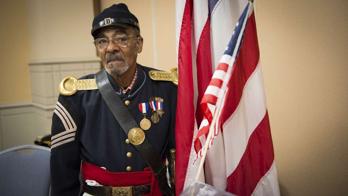 Sergeant Major Joseph Lee poses for a photo in his Civil War re-enactment uniform during the Black History and Culture Showcase at the Pennsylvania Convention Center in Philadelphia. (Branden Eastwood for NewsWorks)