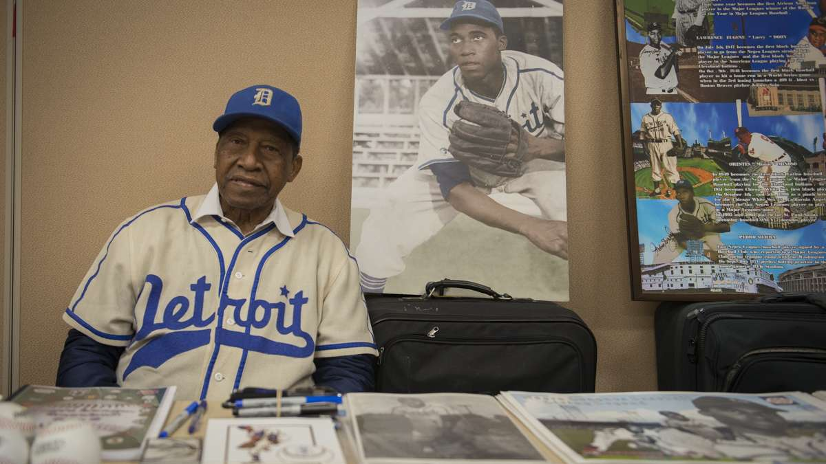 Pedro Sierra, the last Negro League baseball player to be signed by a Major League team, poses for a photo at the  Black History and Culture Showcase inside the Pennsylvania Convention Center in Philadelphia. (Branden Eastwood for NewsWorks)