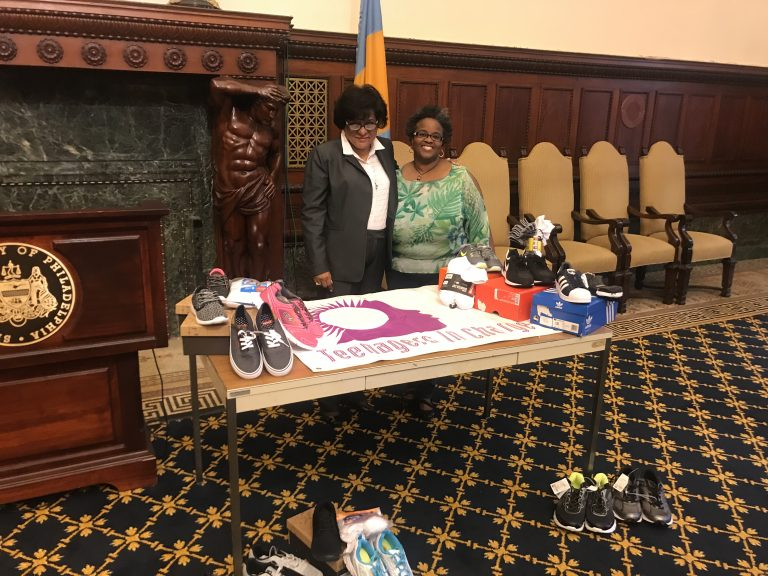 Councilwoman Jannie Blackwell and Judith McDaniel talk about the effort to collect 1,000 pairs of sneakers for homeless youth. (Courtesy Teresa Lundy)
