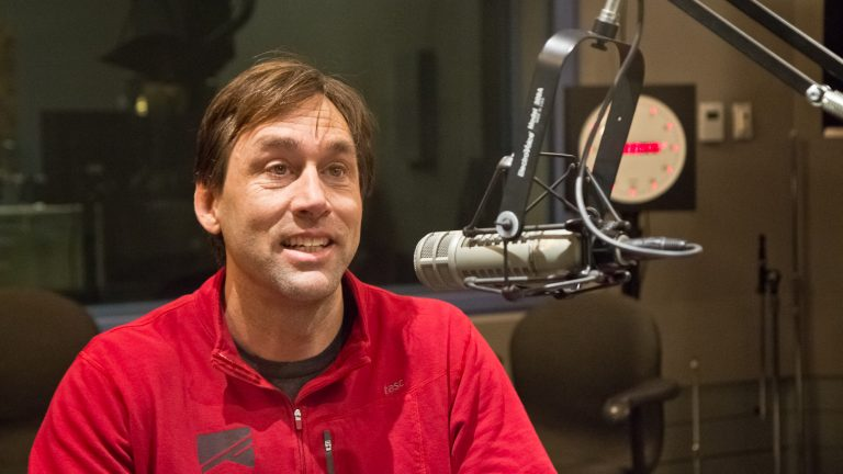 Erik Weihenmayer, author of 'No Barriers: A Blind Man's Journey to Kayak the Grand Canyon,' visits WHYY studios Tuesday. (Kimberly Paynter/WHYY)