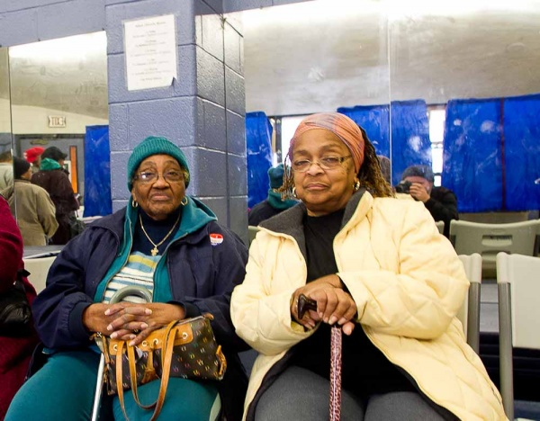 <p><p>Rochele Hilton (right) and Thelma Pienson (left) wait for a polling station to open at the Awbury Recreation Center in Germantown. Hilton, a lifelong Germantown resident, says she has missed only one election in 52 years of voting. (Brad Larrison/For NewsWorks)</p></p>