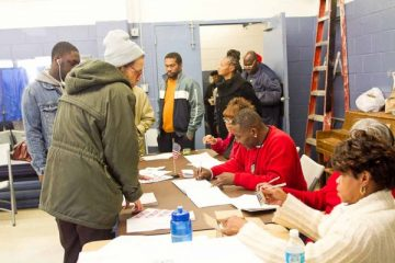 Voters line up to check in with poll workers at the Awbury Recreation Center in the Germantown neighborhood of Philadelphia. (Brad Larrison for WHYY)