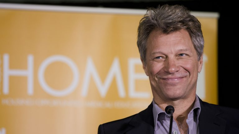 Jon Bon Jovi is shown speaking during the grand opening of a low-income housing development that bears his initials, the JBJ Soul Homes, on Tuesday, April 22, 2014, in Philadelphia. (AP Photo/Matt Rourke)