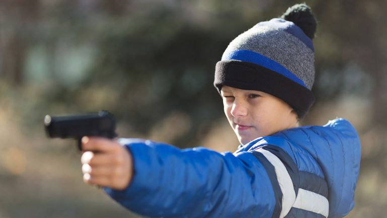 Boy holding a toy gun. (Big Stock file photo)