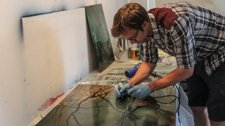 Greg Dunn is a neuroscientist and artist who depicts neurons in mediums such as microetchings and ink. (Kimberly Paynter/WHYY)