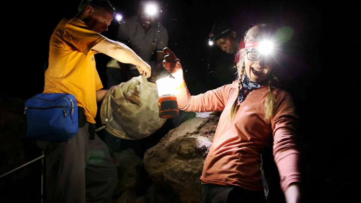 Emily Graslie in a Cave in Kenya.  (Courtesy of Greg Mercer of the Field Museum)