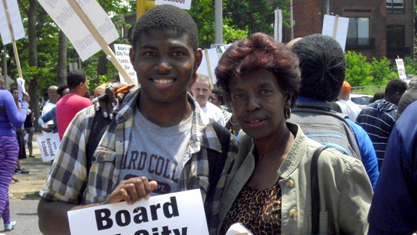 Brandon Dixon and his mother are shown at Girard College in Philadelphia on June 14, protesting a plan to eliminate grades nine through 12 at the end of next year. (Image courtesy of Brandon Dixon.)