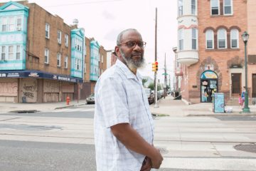 Alfred Tribble considers filing a lawsuit against the Philadelphia Police Department after his son was injured by an off-duty police officer in Brewerytown. (Annette John-Hall/WHYY)