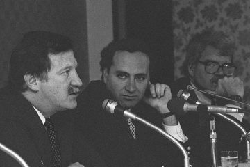 Bruce A. Morrison, left, D-Conn., is shown speaking at a press conference in 1987 as Rep. Charles E. Schumer, center, D-N.Y., and Rep. George Miller, D-Calif., look on. (AP Photo/Koji Sasahara/stf, file)