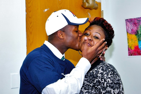 Will Parks gives his mother Nyerere a quick kiss on her cheek. (Bas Slabbers/for NewsWorks)
