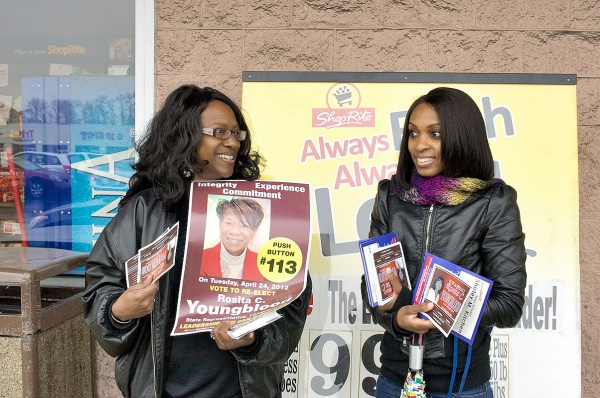 Youngblood's campaign manager Thera Martin Milling and a campaign volunteer stand outside of ShopRite at Olney One Shopping Center. (Bas Slabbers/for NewsWorks)