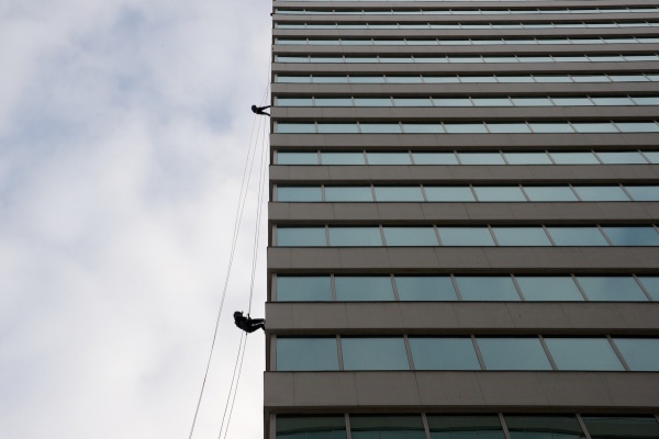 <p><p>Two students at Springside Chestnut Hill Acedemy are decending the 21-story building. (Bas Slabbers/for NewsWorks)</p></p>
