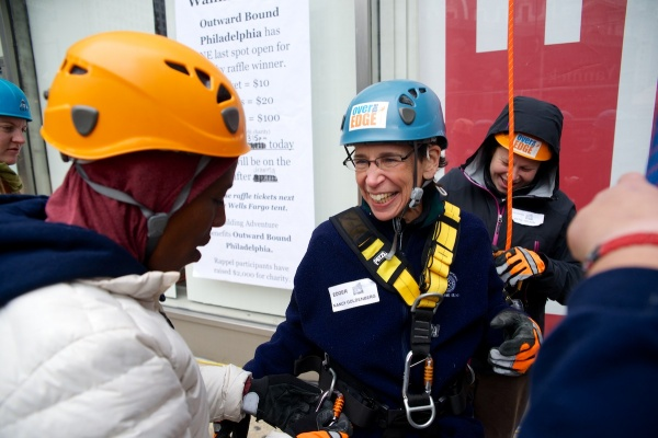 <p><p>Nancy Goldenberg is unlocked from the rope after a safe descent. (Bas Slabbers/for NewsWorks)</p></p>