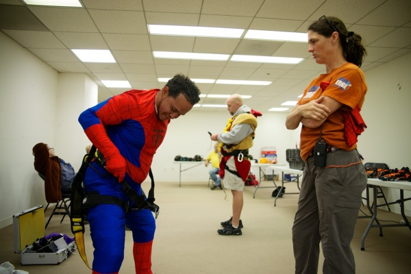 <p><p>Fernando Ezhevrry suits up in a Spiderman costume before rappeling down the building. (Bas Slabbers/for NewsWorks)</p></p>