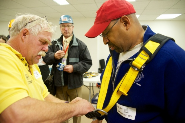 <p><p>Mayor Michael Nutter gets his harness fitted before heading to the roof. (Bas Slabbers/for NewsWorks)</p></p>