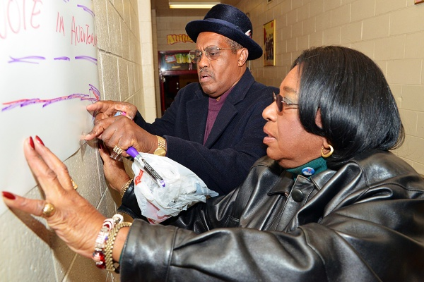 <p><p>Ninth District Councilwoman Marian B. Tasco adjusts signs at the Finley Recreation Center. (Bas Slabbers/for NewsWorks)</p></p>