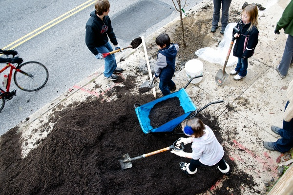 <p><p>Students spread mulch out at the tree planting site outside of James Dobson Elementary. (Bas Slabbers/for NewsWorks)</p></p>
