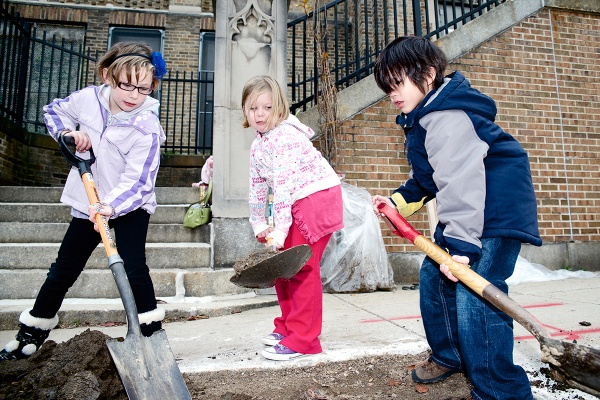 <p><p>Dobson Elementary students Jade, 7, Hope, 5, and Jaden, 7, excavate a hole for one of the five trees. (Bas Slabbers/for NewsWorks)</p></p>