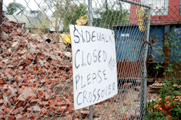 <p><p>A sign posted at the Van Straaten and Havey silk-mill demolition site in Wayne Junction urged passersby to steer clear. (Bas Slabbers/for NewsWorks)</p></p>