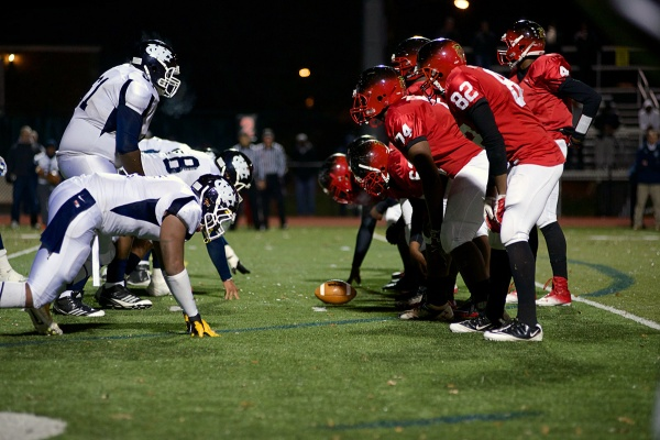 <p><p>The teams face off at the line of scrimmage in Germantown. (Bas Slabbers/for NewsWorks)</p></p>