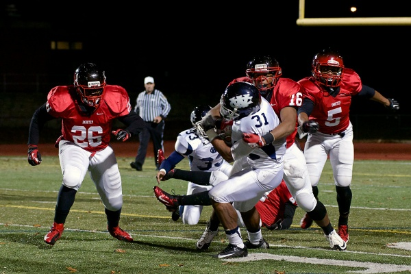 <p><p>Imhotep Panther Randell Hunter drags a West Catholic player to the ground. (Bas Slabbers/for NewsWorks)</p></p>