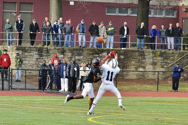 <p><p>Imhotep's Nyeem Thrones attempts to stop Wyomissing's from catching a pass Joe Cacchione. (Bas Slabbers/for NewsWorks)</p></p>