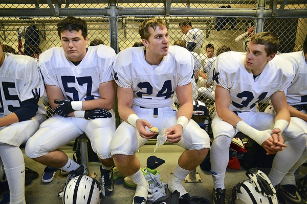<p><p>In the Wyomissing locker room before the game, Connor Reedy, team captain and Notre Dame recruit Alex Anzalone and Scott McAvoy sit quietly as noise from a raucous Imhotep room fills the air. (Bas Slabbers/for NewsWorks)</p></p>