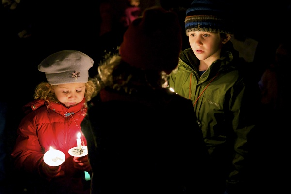 <p><p>Young children watch as the candles light up the park. (Bas Slabbers/for NewsWorks)</p></p>