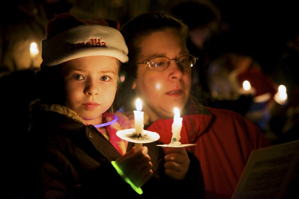 <p><p>Some carolers used two candles for better illumination. (Bas Slabbers/for NewsWorks)</p></p>